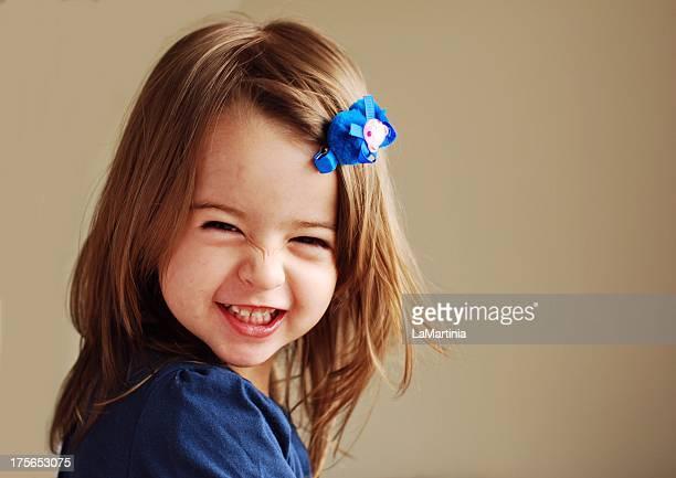Girl in blue smiling