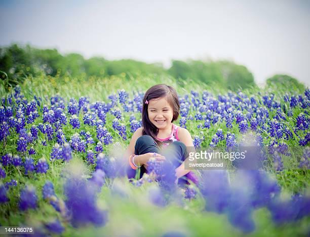 Girl in bluebonnet field