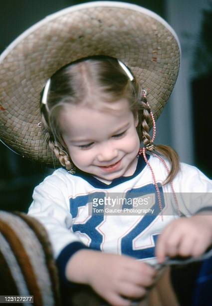 Girl in braids and cowboy hat