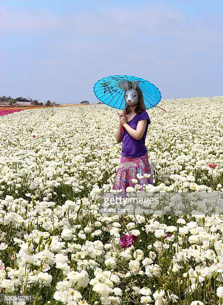 Girl in bunny mask with parasol