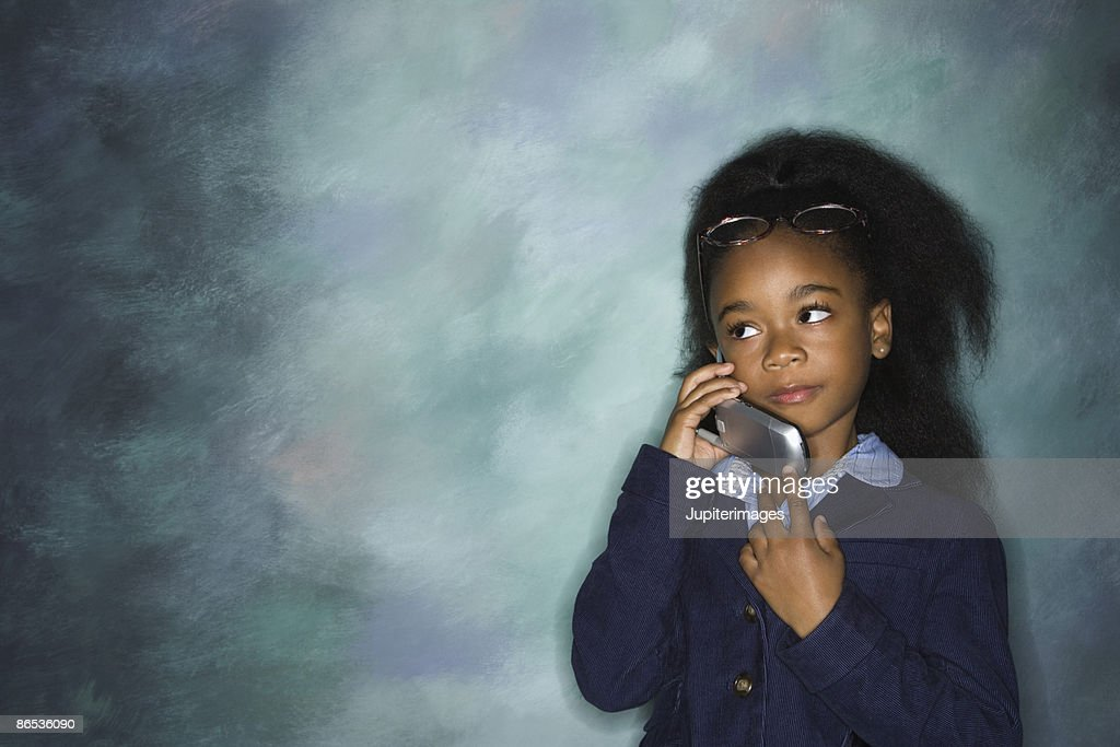 Girl in business attire with cell phone : Stock Photo