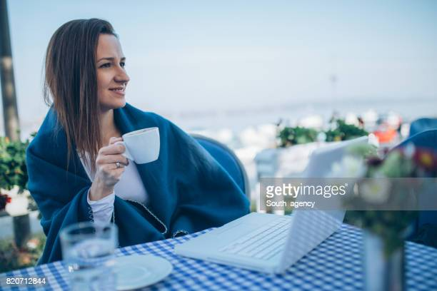 Girl in cafe drinking coffee