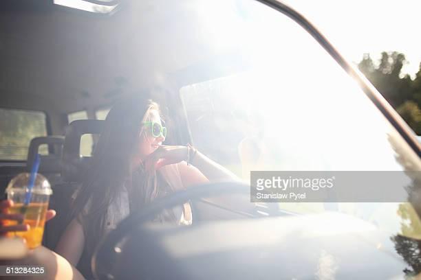 Girl in car enjoying bubble tea