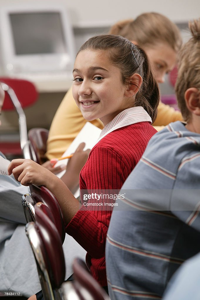 Girl in classroom : Stockfoto