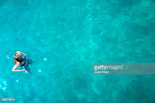 Girl in clear blue sea