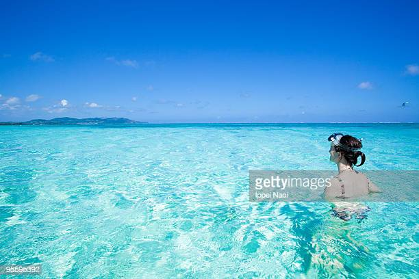 Girl in clear blue tropical water, Okinawa