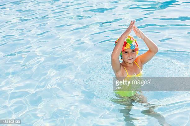 Girl in colorful swim cap