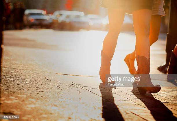 girl in cowboy boots walking on lower broadway street, nashville - countrymusik bildbanksfoton och bilder