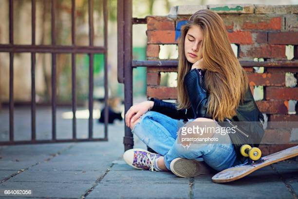 girl in depression is standing sad on the groung - puss pics stock photos and pictures