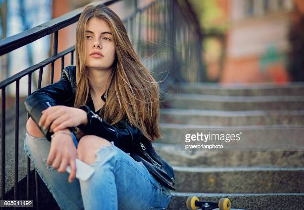 girl in depression is standing sad on the stairs - nasty little girls stock photos and pictures