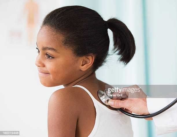 Girl (6-7) in doctor's office