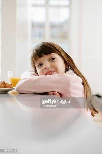 Girl in dressing gown having breakfast