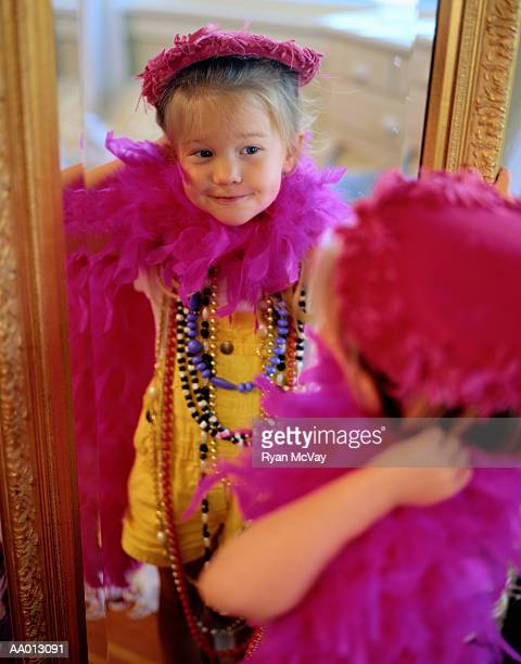 Girl in Dress-Up Clothes Looking in the Mirror