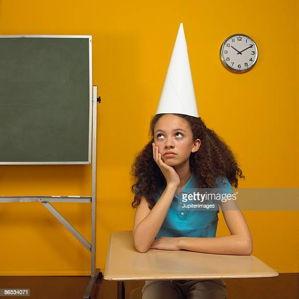 girl in dunce cap - dunce's hat stock pictures, royalty-free photos & images
