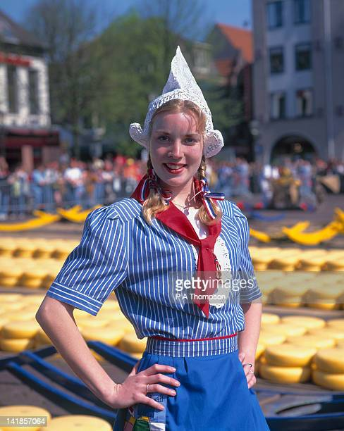 girl in dutch national costume, alkmaar, netherlands mr - dutch culture stock pictures, royalty-free photos & images