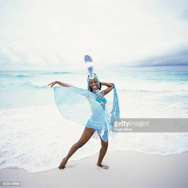girl in elaborate costume at the beach - hugh sitton stockfoto's en -beelden