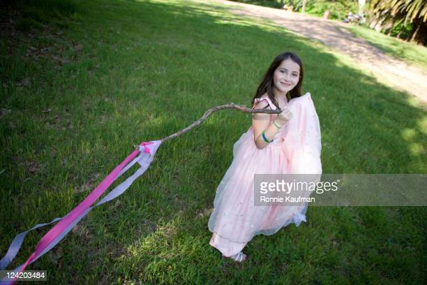 girl in elegant dress holding stick - grace kaufman stock pictures, royalty-free photos & images