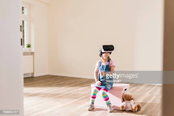 girl in empty apartment wearing vr glasses - digital native stock pictures, royalty-free photos & images