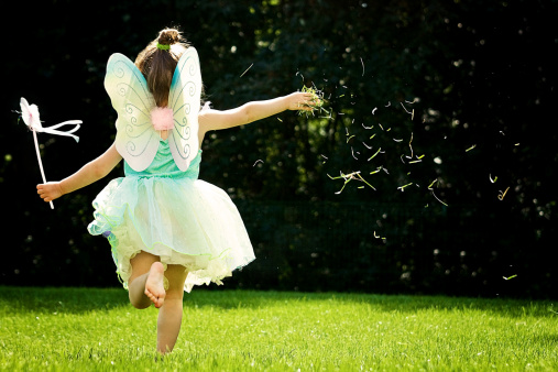 A girl in fairy costume running and thowing grass - gettyimageskorea