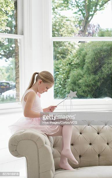 girl (8-9 years) in fairy costume using digital tablet - 8 9 years stock pictures, royalty-free photos & images