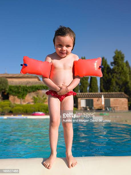Girl in floaters at swimming pool
