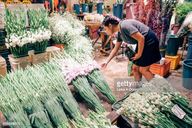Girl in flower market
