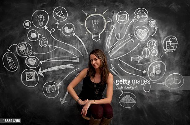 girl in front of chalkboard with social media icon - solo una donna giovane foto e immagini stock