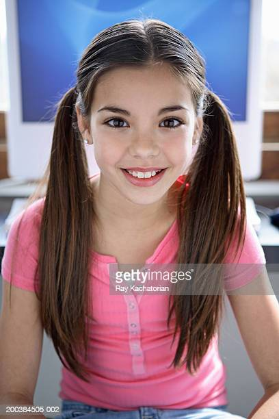 Girl (10-12) in front of computer