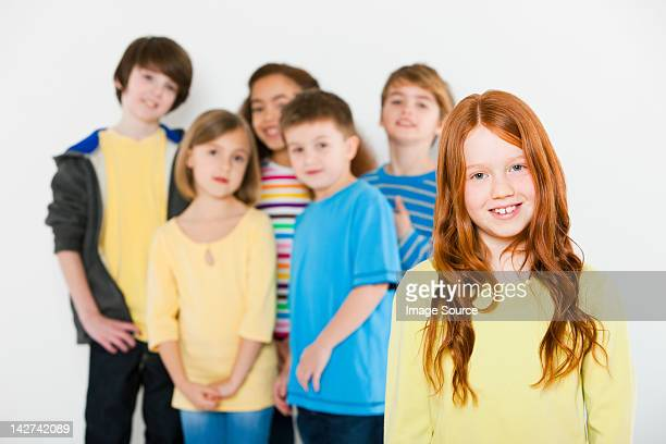 Girl in front of other children