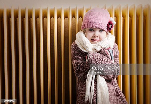 girl in front of radiator - cold temperature stock pictures, royalty-free photos & images