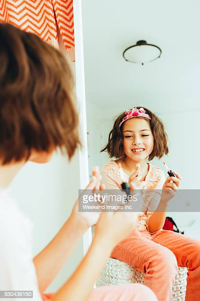 Girl in front of the mirror