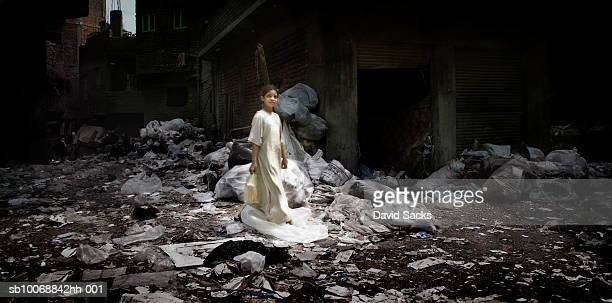 Girl (6-7) in garbage strew alley