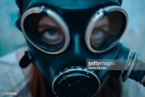 girl in gas mask - gas mask stock pictures, royalty-free photos & images
