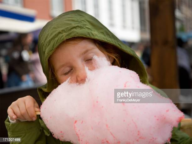 girl in green, eating cotton candy