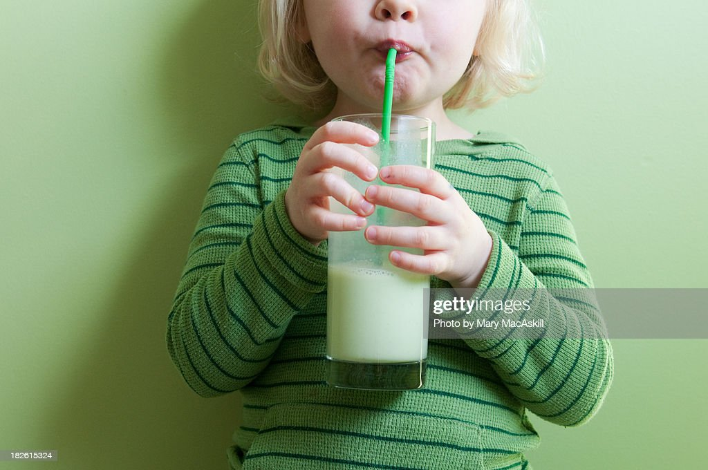 Girl in Green Sipping Green Milkshake : Stock Photo