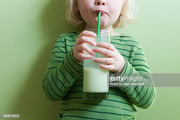 girl in green sipping green milkshake - food and drink stockfoto's en -beelden