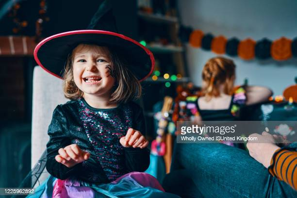 a girl in halloween costume and face painted pulling a face. - halloween stock pictures, royalty-free photos & images