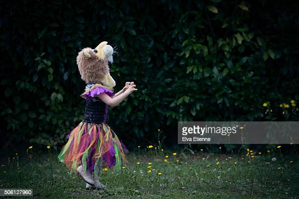Girl in halloween costume running in garden