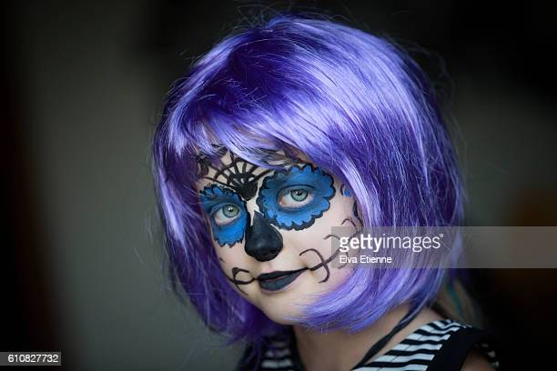 girl in halloween face paints - purple hair stock photos and pictures