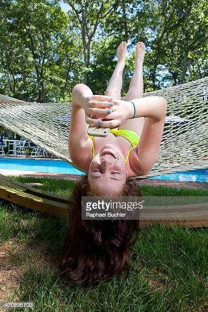 Girl in hammock using mobile phone
