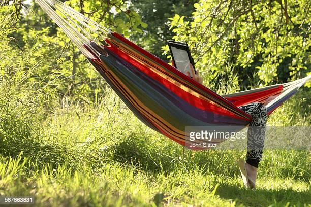 girl in hammock using tablet device