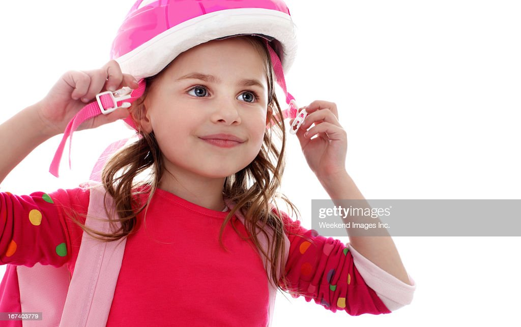 Girl in helmet : Stock Photo