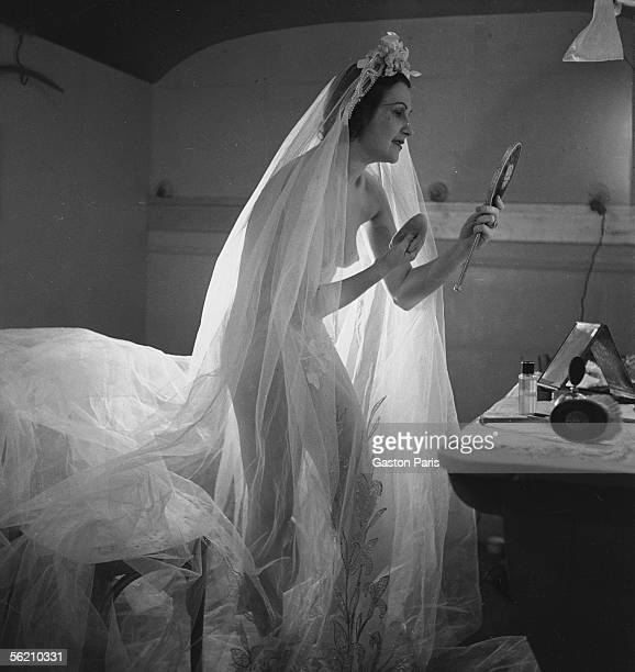 Girl in her dressing room at the FoliesBergere Paris about 19371939