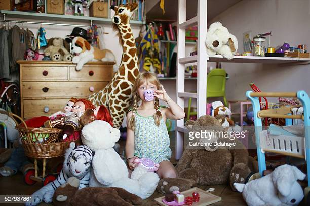 A girl in her filled bedroom