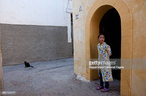 Girl in her home doorway in the walled Portuguese city