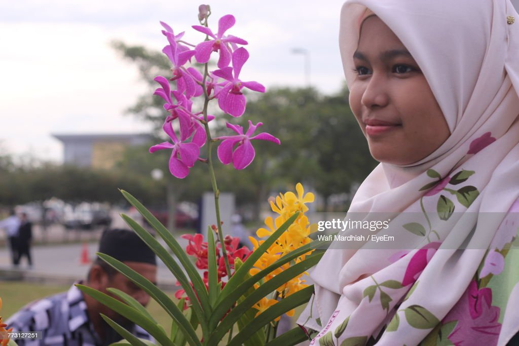 Girl In Hijab By Plants At Park : Photo