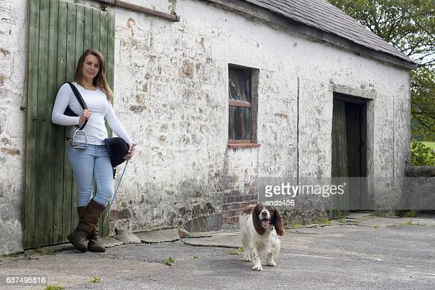 girl in horse  riding clothes with dog - riding crop stock photos and pictures