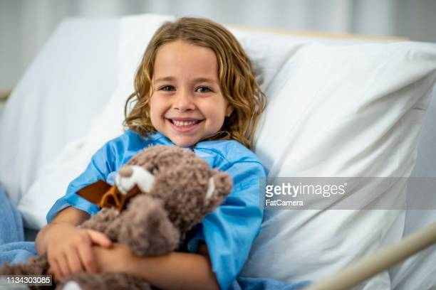 girl in hospital bed - cancer illness stock pictures, royalty-free photos & images