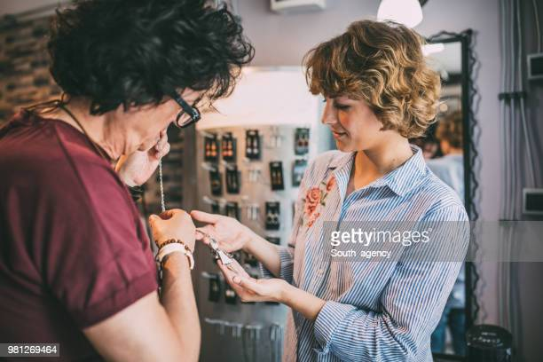 girl in jewelry store - jewellery products stock photos and pictures