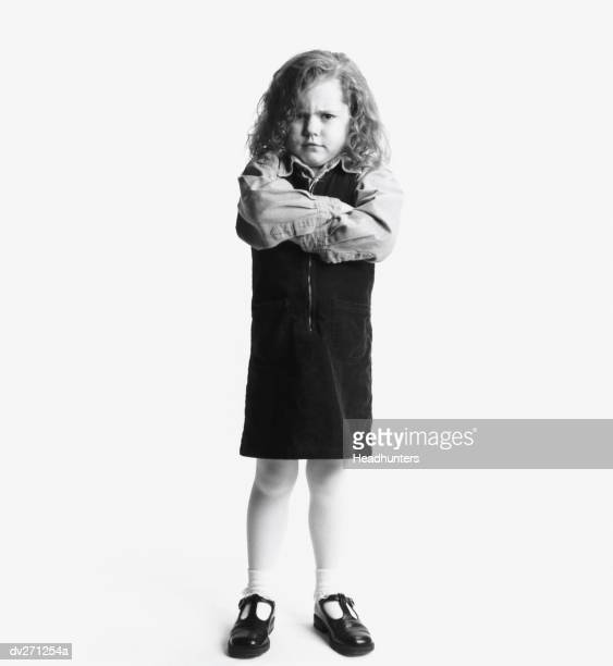 girl in jumper with arms crossed - headhunters stock pictures, royalty-free photos & images
